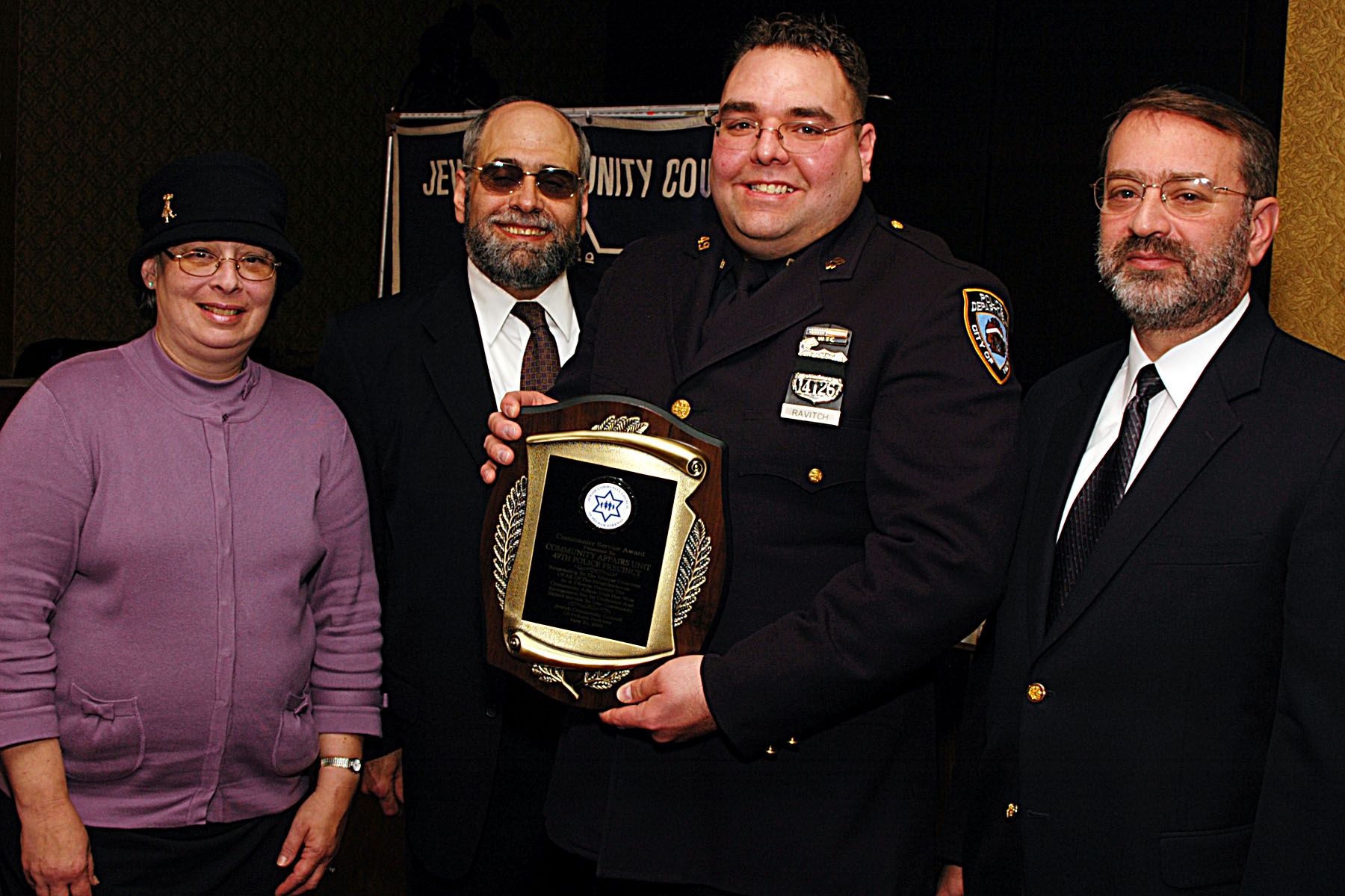 The Council presented its Community Service Award to the Community Affairs Unit of the 49th Police Precinct.